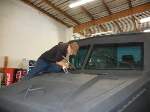 Sam cutting out old windshield