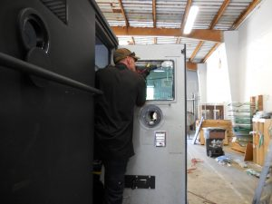 Sam working on passenger side door glass
